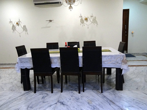 In Feng Shui, a rectangle dining table is the less acceptable as it exaggerates the hierarchical relationship of the people seated