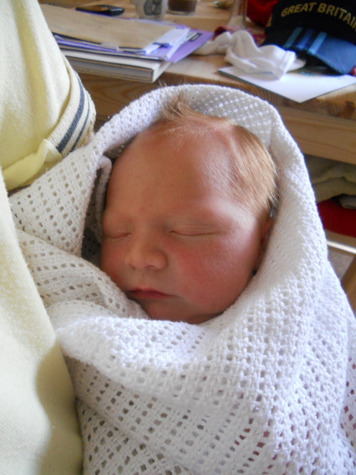 Tightly swaddling your baby's arms and legs can give him the security to drift off to sleep. Check out the video to see how to swaddle correctly - it's easier than you think