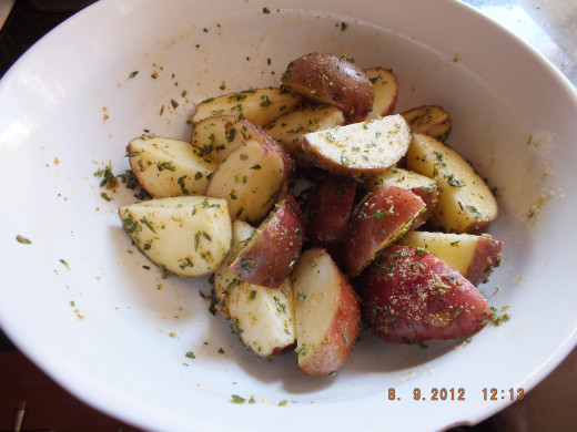 Add to a bowl with fresh and dried herbs along with the olive oil
