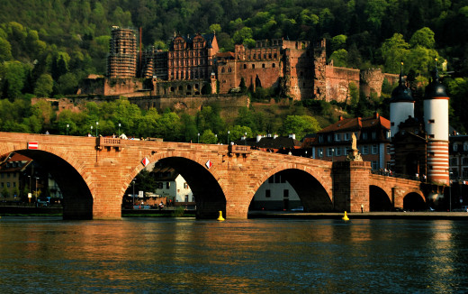 Old Stone Bridge and remains of the Heidelberg Castle in the background in Heidelberg, Germany