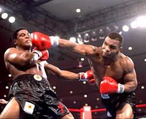 Mike Tyson clocks Trever Berbick in route to becoming youngest Heavyweight Champion of the World