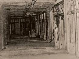 A popular photograph of a ghostly figure peering out from a doorway,taken at Waverly Hills. Real or fake? You decide.