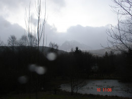 A winter view of Ben Nevis, the top shrouded in cloud and snow.