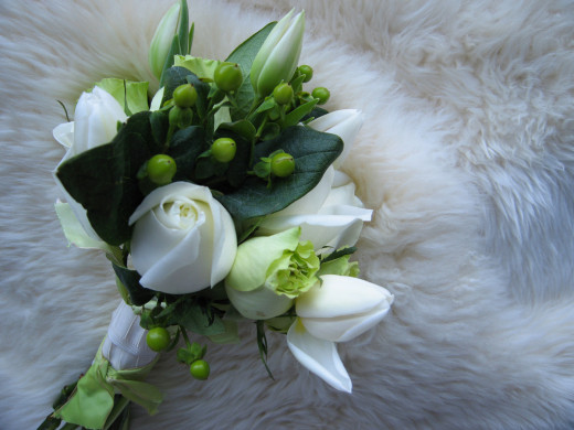 Modern nosegay of white roses.