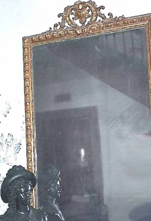 A mirror inside the home,where hand prints are seen to appear from nowhere on the mirrors surface.