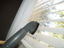 Eureka Bagless Upright Vacuum Cleaner - Using the Brush to Clean the Window Blinds.