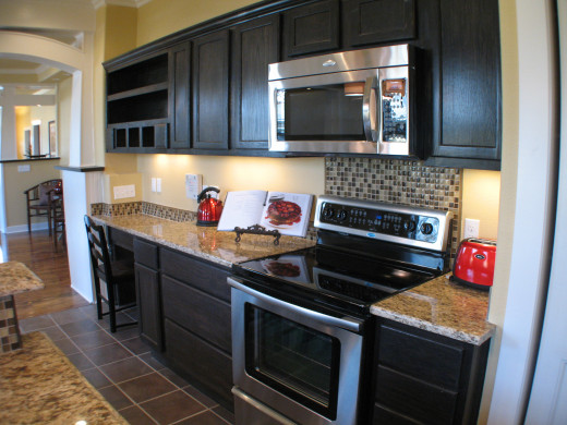You can vary the sizes of the backsplash to create a focal point without changing materials.