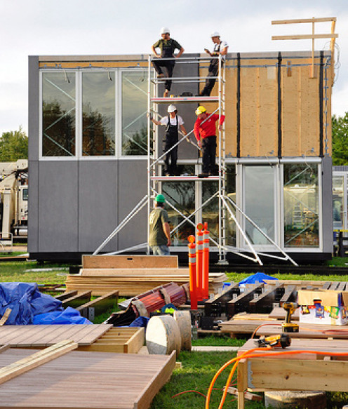 Modular home sections being assembled on-site.