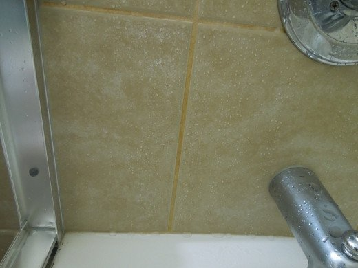 Water Stain on Tile Grout in A Bathtub