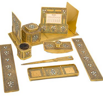 Tiffany Studios of New York City, New York, manufactured this beautiful nine-piece, gilt-bronze desk set circa 1900.