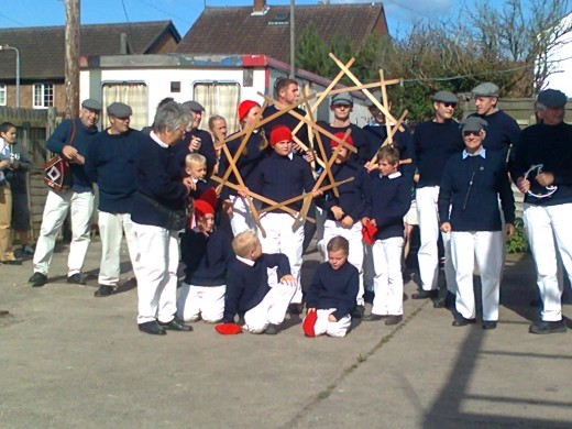 Flamborough Sword Dancers holding their wooden sword locks