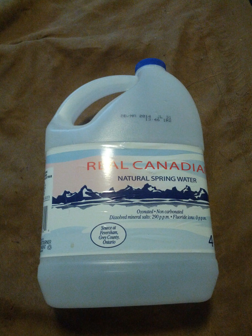 Start with a 4-ltr plastic water jug (this is in Canada - I'm sure you can find appropriately sized plastic water jugs in your area)
