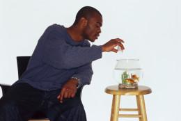 Man feeding fish