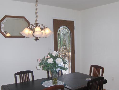 This same leaded glass door was put on the dining room area to give a view of the outside from the dining room but still be private.