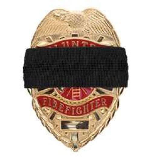 The black band worn over the badge is a sign that a loss has happened in that departmet.