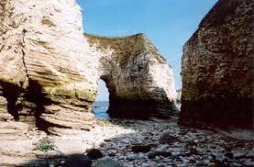 Hollowed-out chalk cliffs of Flamborough. The sea 'eats' rock just the same as summer holidaymakers eat the candy variety at the seaside.