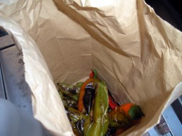 Dump the blackened peppers into a paper sack