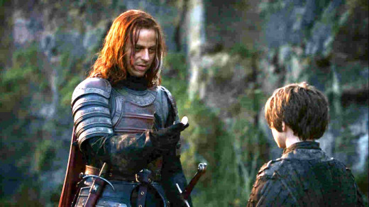 Jaqen H'ghar giving Arya his coin.