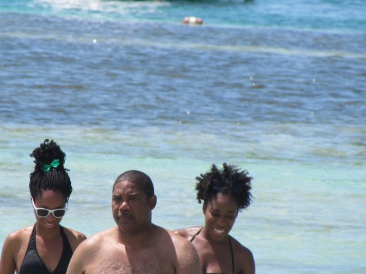 My husband Walker and daughters, Wanisha and Jaleesa play in the water at Cococay, Bahamas. Afterward we enjoyed a delicious Royal Caribbean barbeque on the island.