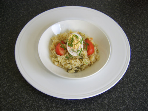 Spicy deviled duck egg is served on a bed of rice and peppers