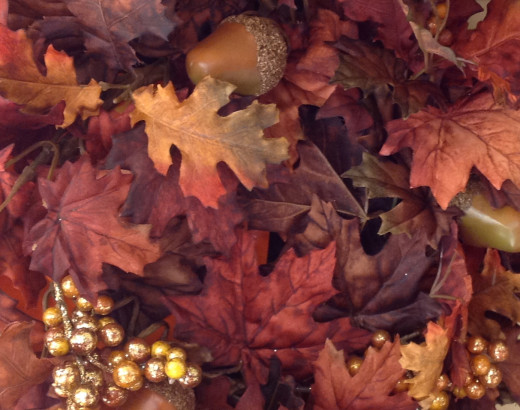 Berries, nuts, and fall leaves make wonderful additions to holiday decorations.