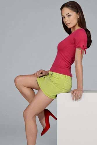 Kristin Kreuk in a mini-skirt looking sexy