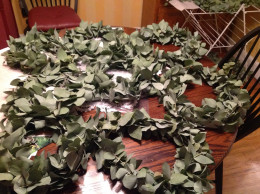 Wreaths filled the dining room table, and eventually there were two layers.
