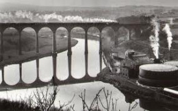 Larpool Viaduct in the days of steam with a Whitby/Teesside train, passing over the gas works on the way to Prospect Hill and Whitby west Cliff or Whitby Town