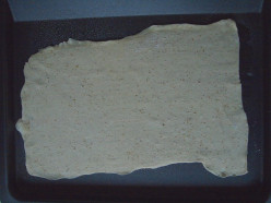 Roll out the puff pastry on a lightly floured surface to form a large and thin rectangle.