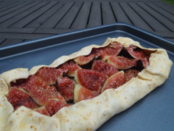Fold the pastry rim to wrap the figs, packing it tightly around the edges.