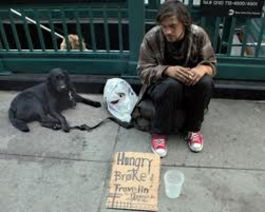 Homeless man and his dog. Both Hungry.