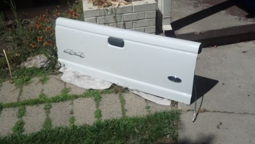 I saw this tailgate for sale online, fits a Ford Ranger, less than $300. New, this would be quite a bit more.