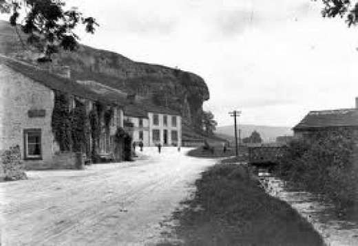 Kilnsey village with the overhanging Kilnsey Crag in days gone by