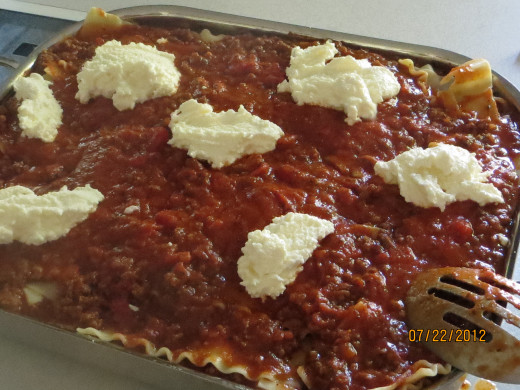 Optional: dollops of ricotta on top layer of meat sauce