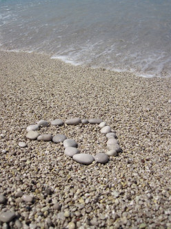 stone heart on beach