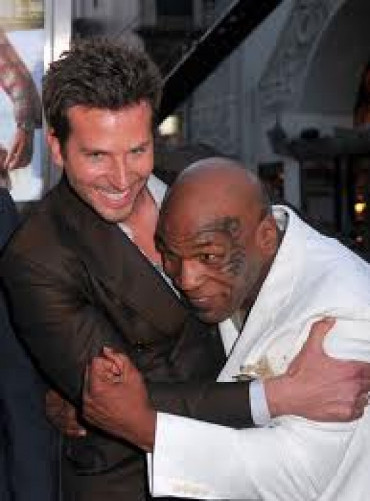 Mike Tyson with a Hangover cast member. Iron Mike has had guest spots on many films including: The Hangover 1 and 2 and two of the Scary Movie sequels.
