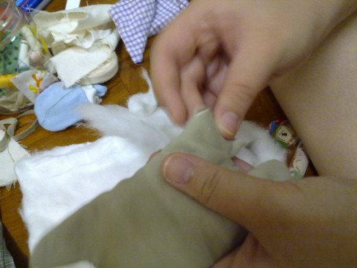 Turn the inside cloth out. Fill in the cotton thru the small gap