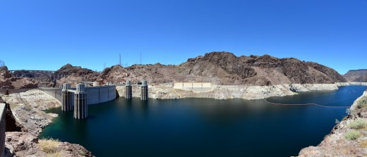 Hoover Dam 2011 panoramic view from the Arizona side showing the penstock towers, the Nevada-side spillway entrance and the Mike O'Callaghan – Pat Tillman Memorial Bridge, also known as the Hoover Dam Bypass