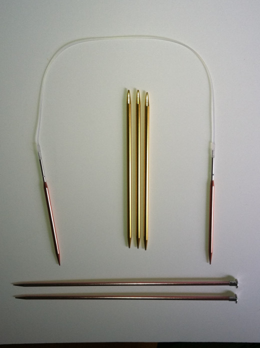 Bottom: Single Point (Straight) Knitting Needles Center: Double Pointed Knitting Needles Left/Top/Right:  Circular Knitting Needles