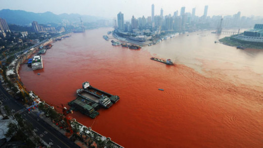 This photo of the Yangtze Rivers clearly shows this red dust. Chemical spills, landslides of red clay and red tide have all been ruled out.