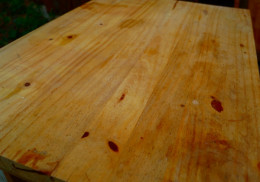 This is the top of the table, and it's got some dirt and light stains from using it without staining the wood first.