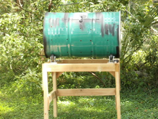 Steel drum composter with door and bottom access.