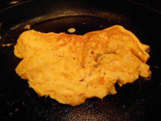 Flip over the entire omelette, cook for further one to two minutes and then remove fom pan