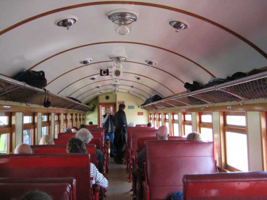 Inside the steel car of the steam train, New Zealand.