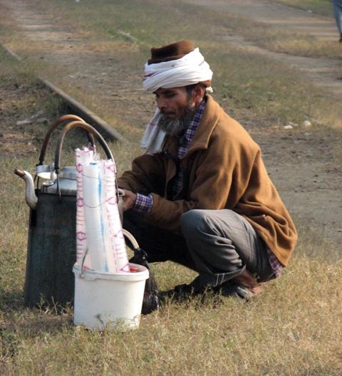 Tea-vendor outside the western gate of Race Course.