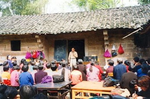 Freddie Sun addresses a congregation