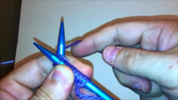 Draw the yarn behind and to the right of the Left Hand needle