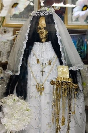 The most important feast of the Holy Death followers falls on August 15. On the same day Catholics celebrate celebration Assumption.