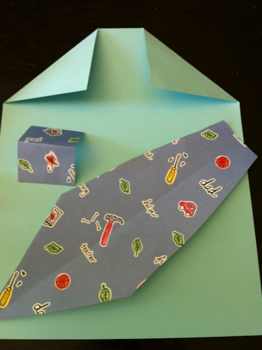 Cut out tie, with some fun patterned scrapbooking paper Fold a collar on a piece of paper