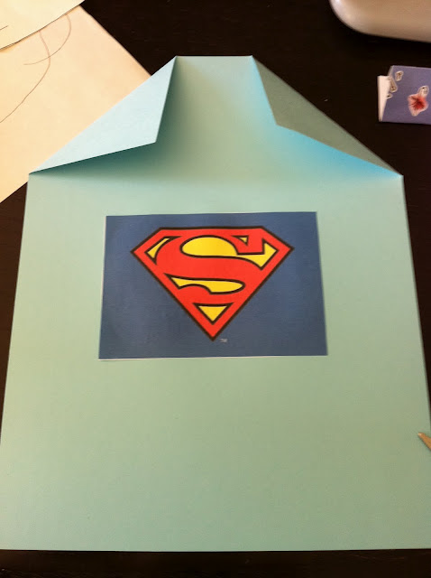 I printed this Superman symbol from online, but you could easily make your own.